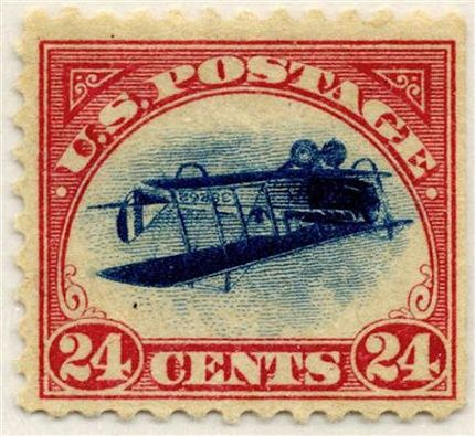 Марка с изображением перевернутого аэроплана Кертис-Дженни