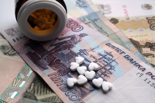 Таблетки на денежных купюрах