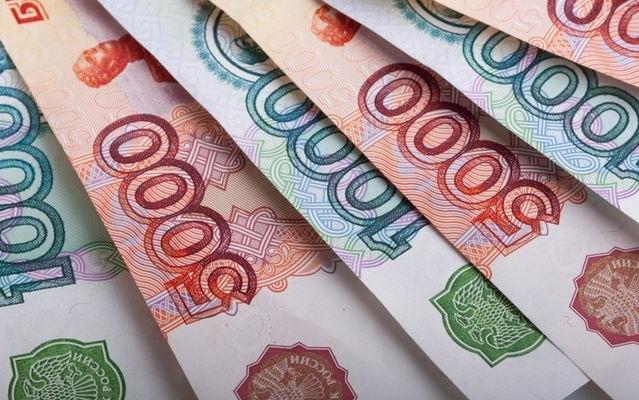 Купюры по 1000 и 5000 рублей